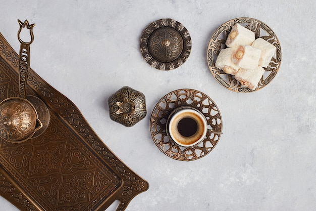 Turkish coffee set with jelly and lokum, top view.