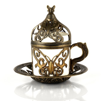 Turkish coffee in traditional copper cookware, a cup of demitass