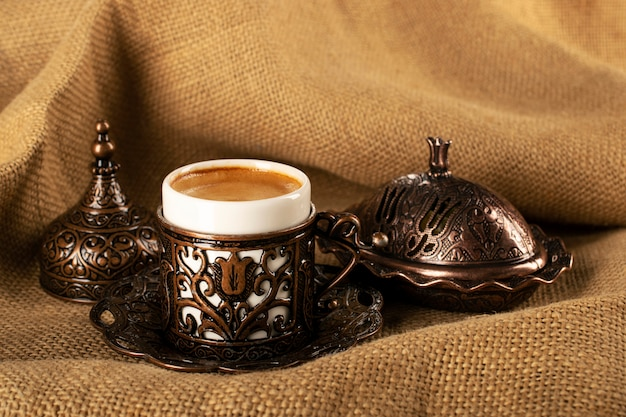 Turkish coffee in traditional copper cookware, turkish delight and demitassa cup