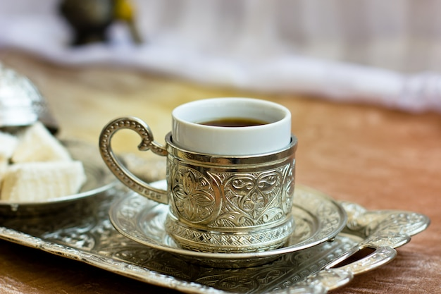 Turkish coffee and turkish sweets lokum on metal tray