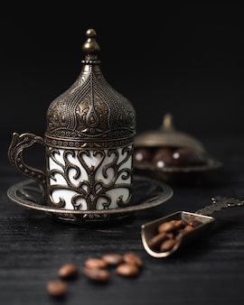Turkish cup of coffee with coffee beans