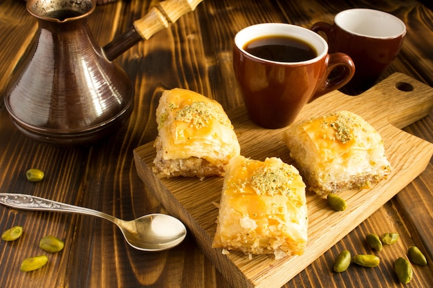 Turkish delight and  coffee on the cutting board on the  brown  wooden background