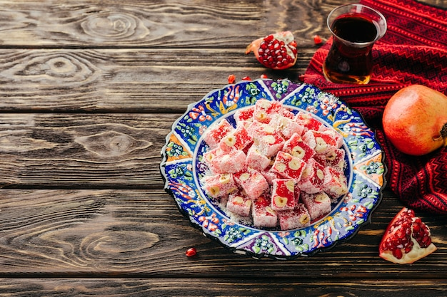Turkish delight. eastern sweets with pomegranate and hazelnuts.