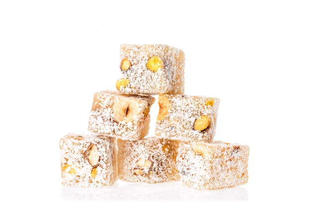 Turkish delight lokum with pistachio nuts isolated on a white