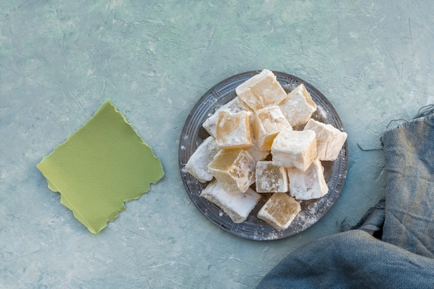 Turkish delight on plate with small paper and cloth