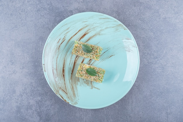 Turkish delight rahat lokum with hazelnuts on green plate