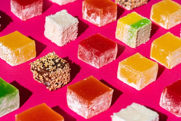 Turkish delight square pieces on a bright pink