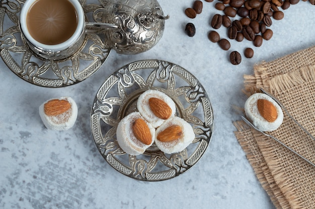 Turkish delight with almond and coconuts placed on plate . high quality photo