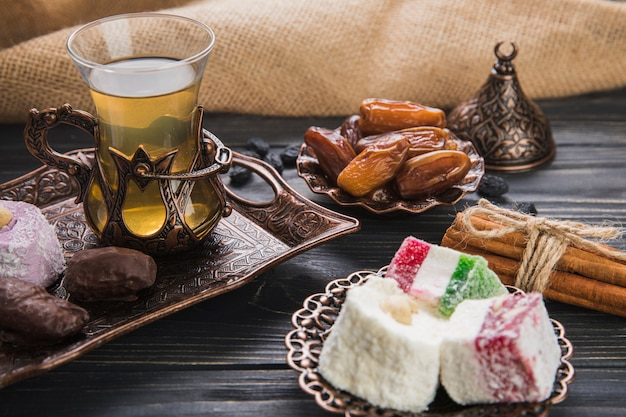 Turkish delight with tea and dates fruit