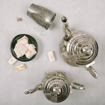 Turkish delight with teapots on light table