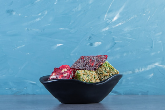 Turkish delights in a bowl, on the marble surface