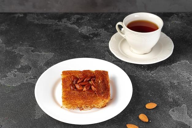 Turkish dessert baklava with nuts on black background