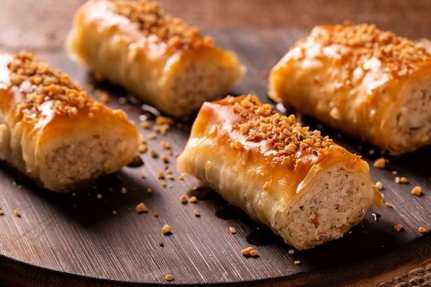 Turkish dessert kadayif on wood background.