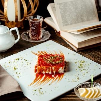 Turkish dessert trileche with caramel sauce