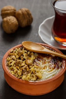 Turkish dessert with rice pudding and hazelnut powder