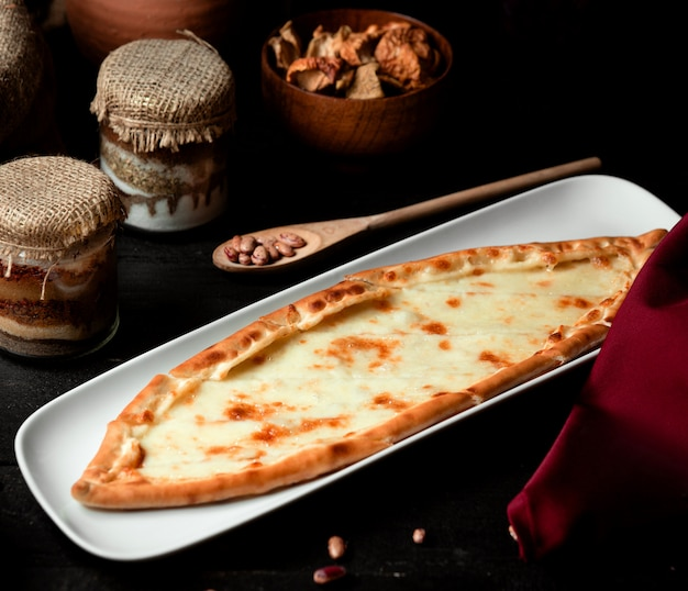 Turkish dish pide with grated cheese