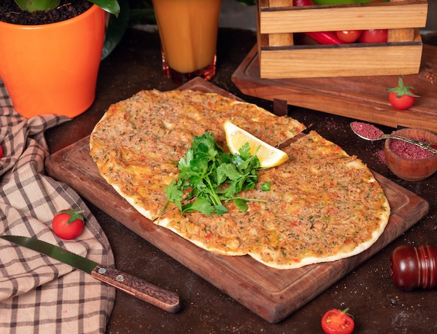 Turkish dishes: lahmacun, turkish pizzas, lemon, parsley