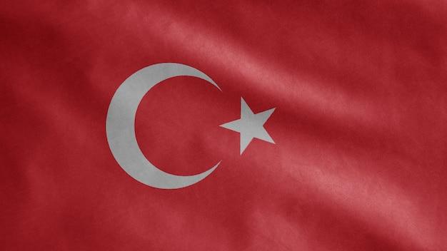 Турецкий флаг развевается на ветру. выдувной шаблон индейки, мягкий и гладкий шелк. предпосылка прапорщика текстуры ткани ткани. используйте его для концепции национального дня и страны.