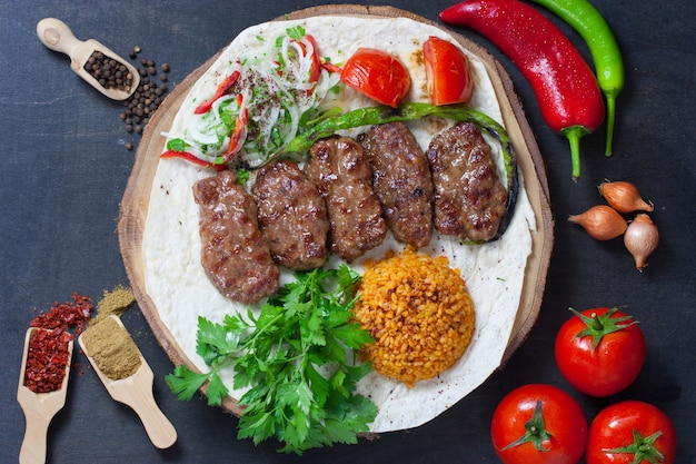 Turkish food kofte stack of meatballs with rice