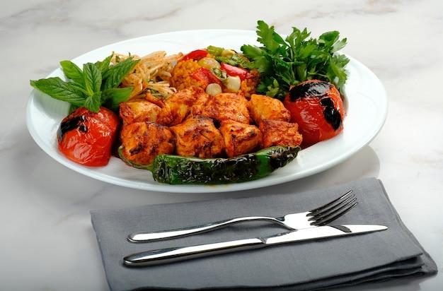 Turkish kebab ready to be served at the table adana urfa chicken shish mixed kebab beyti