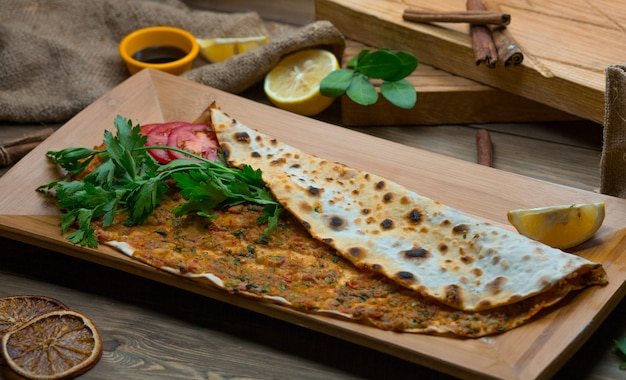 Turkish lahmacun with lemon and fresh parsley