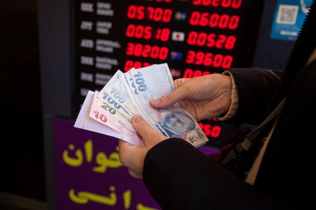 Turkish liras in person's hands. exchange concept.