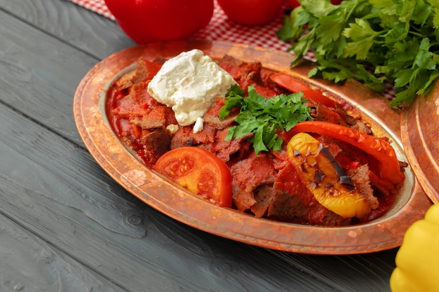 Turkish meat saute with vegetables in copper plate