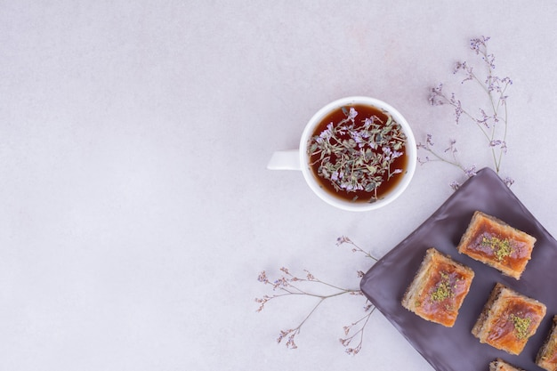 Turkish pakhlava with a cup of herbal tea
