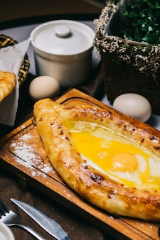 Turkish pide bread with fried egg.