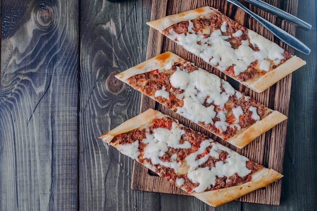 Turkish pide traditional food with beef, vegetables and cheese.