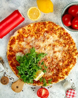 Turkish pide with cheese meat and herbs