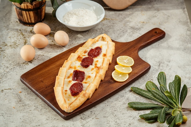 Turkish pide with cheese and salami