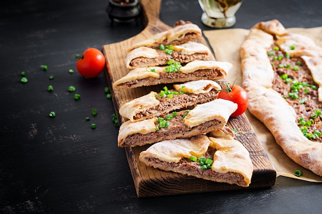 Turkish pide with minced meat, kiymali pide. traditional turkish cuisine. turkish pizza pita with meat.