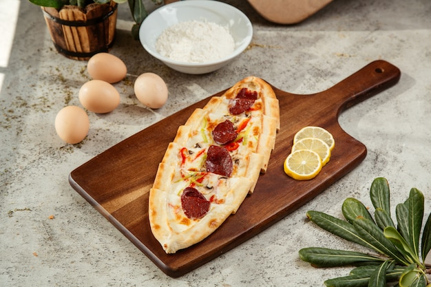 Turkish pide with salami bell peppers mushroom and cheese