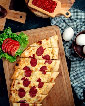 Turkish pide with sausage and cheese