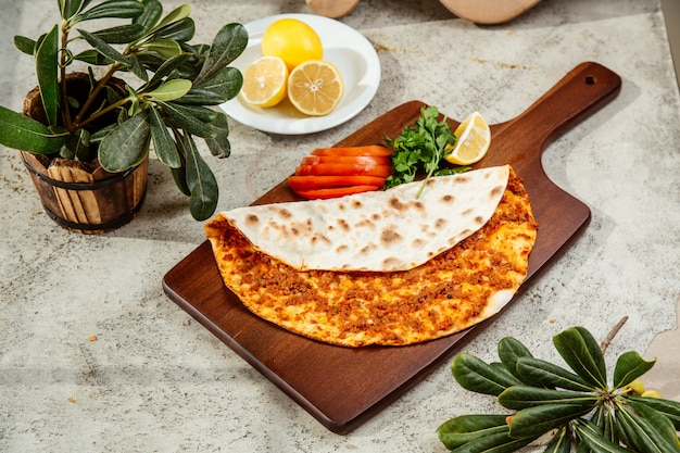 Turkish pizza lahmajun flatbread with minced meat with lemon and parsley