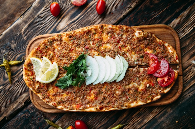 Turkish pizza lahmajun with minced meat on thin crust