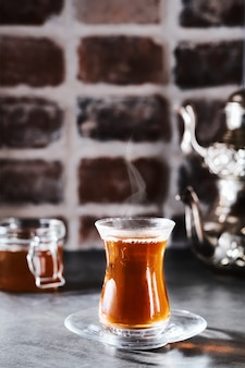 Turkish red aromatic tea in a traditional glass