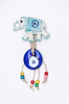 Turkish souvenir evil eye bead and elephant