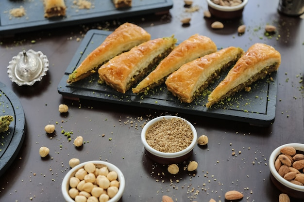 Turkish style dessert havudj dilimi walnuts pistachios syrop dough side view