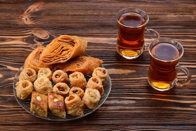 Turkish sweet baklava on plate with turkish tea.