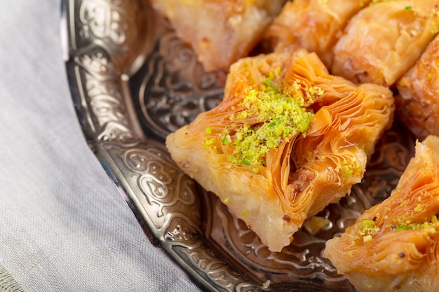 Turkish sweets baklava and metal oriental tray on wooden background