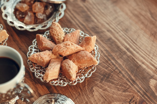 Turkish sweets with coffee on a wooden surface table