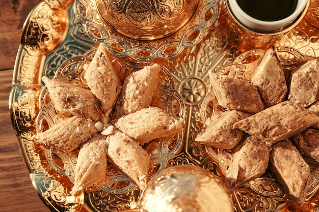 Turkish sweets with coffee on a wooden table