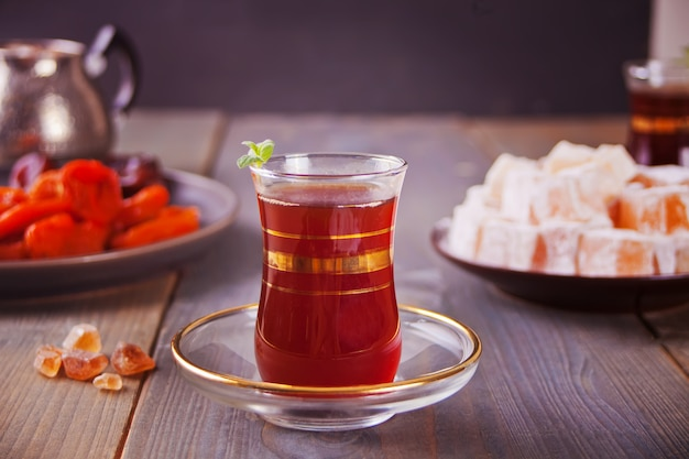 Turkish tea in traditional glass cups on the wooden table
