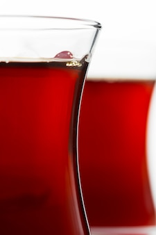 Turkish tea in traditional glass isolated on white background