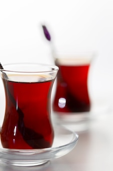 Turkish tea in traditional glass isolated on white