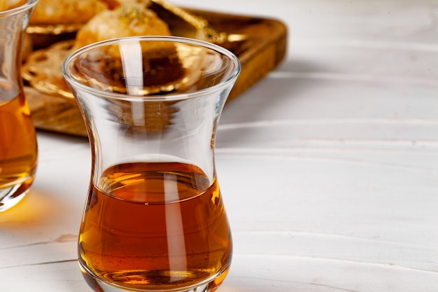 Turkish tea with oriental desserts on table