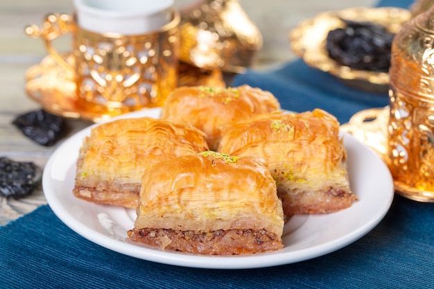 Turkish traditional dessert baklava with tea on dark