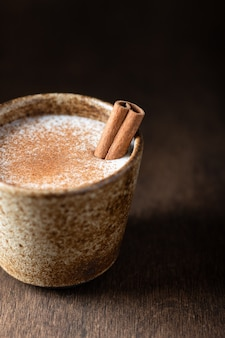 Turkish traditional hot drink salep on wooden background, selective focus